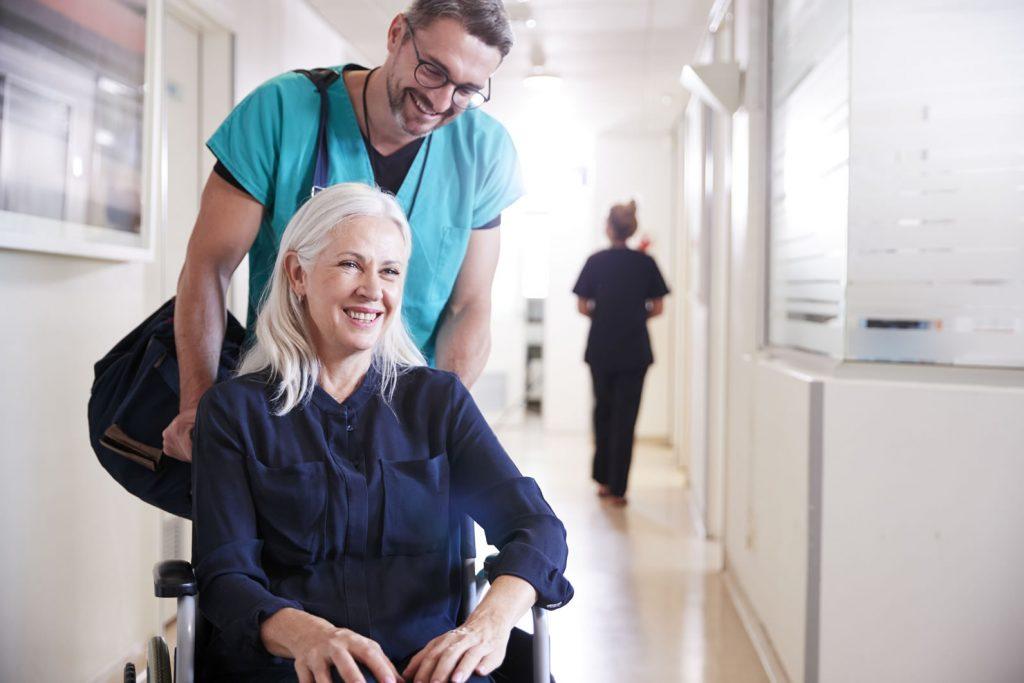Nurse taking care of an elderly woman - malnutrition